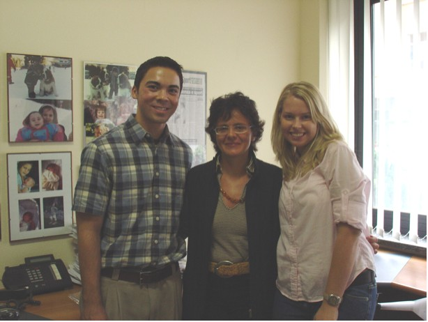 Fig AQ-1: HOPES members Devon McGee and Agnieszka Milczarek with Dr. Elena Cattaneo, center.